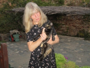 Carol McBeth, holding one of the stray cats she cares for