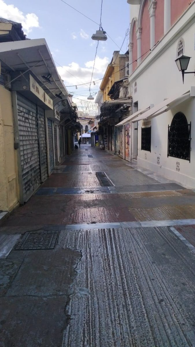 An empty Monastiraki during the pandemic affects stray cat care.
