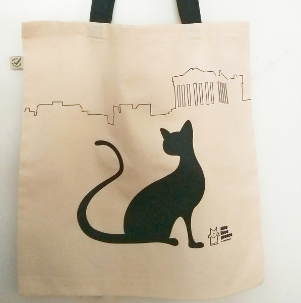A tote bag in our Shop featuring an outline of the Acropolis and a stylized black cat