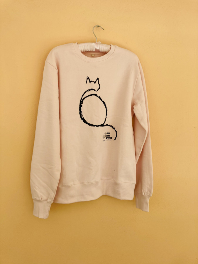 A light pink colored sweatshirt with the white outline of a cat over the Nine Lives Logo