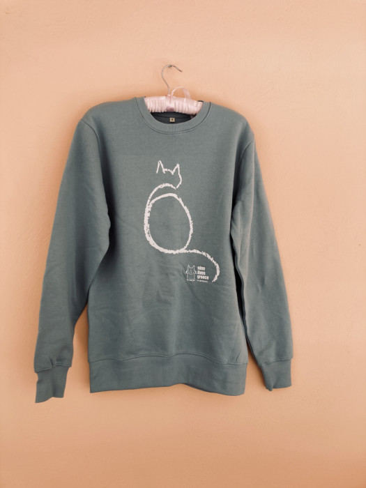 A slate green sweatshirt with the white outline of a cat over the Nine Lives Logo